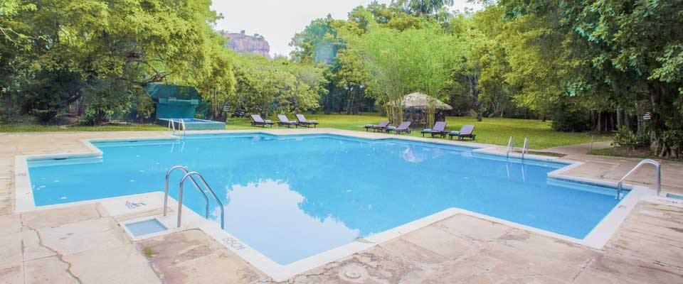 The outdoor swimming pool at the Sigiriya Village Hotel
