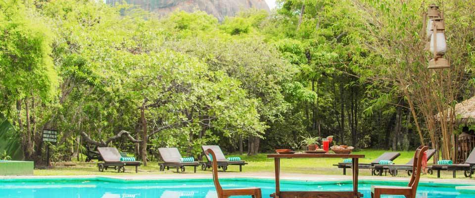 Breakfast by the pool at the Sigiriya Village Hotel