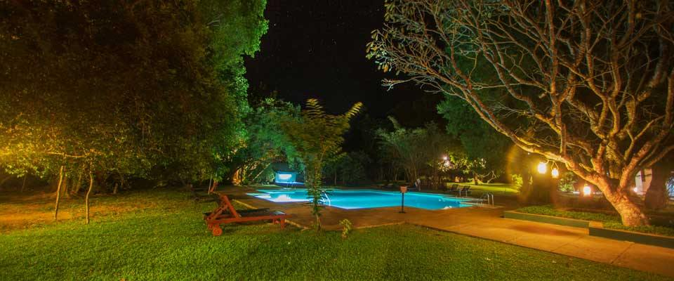 The swimming pool of Sigiriya Village Hotel by the night