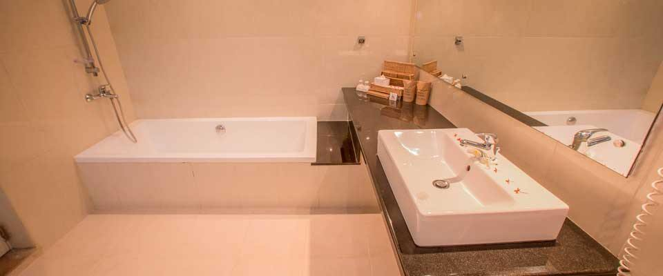 The attached bathroom of the deluxe rooms