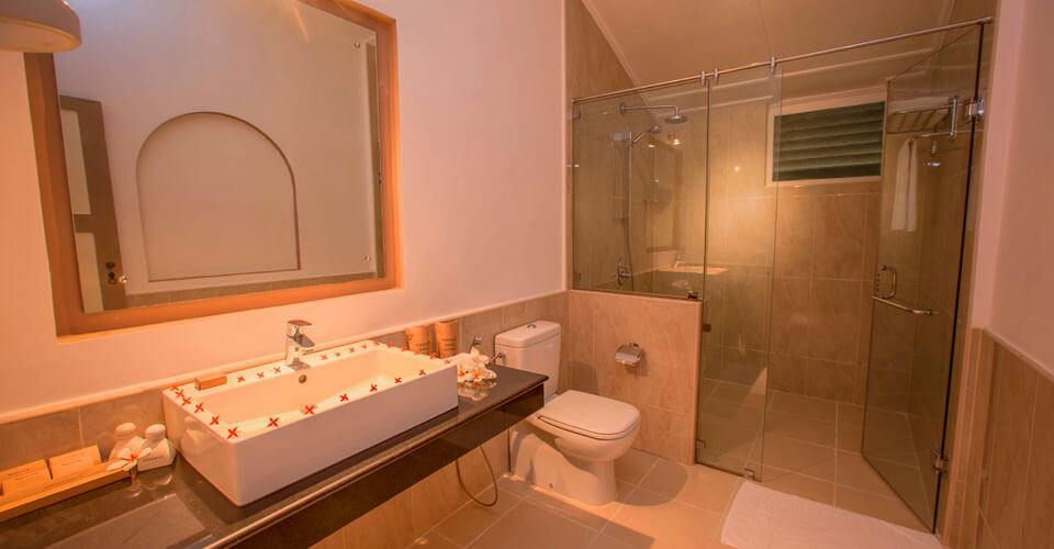 Modern bathroom with hot and cold shower at Sigiriya Village Hotel