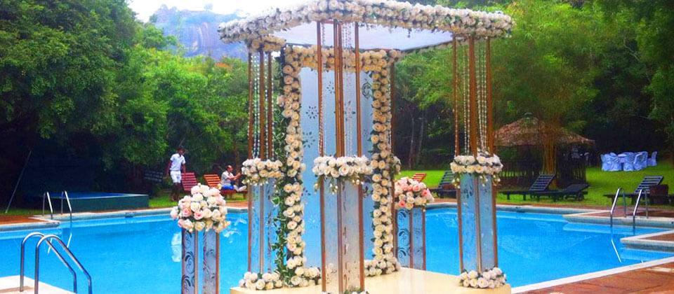 Delicate floral décor for outdoor weddings at Sigiriya Village Hotel