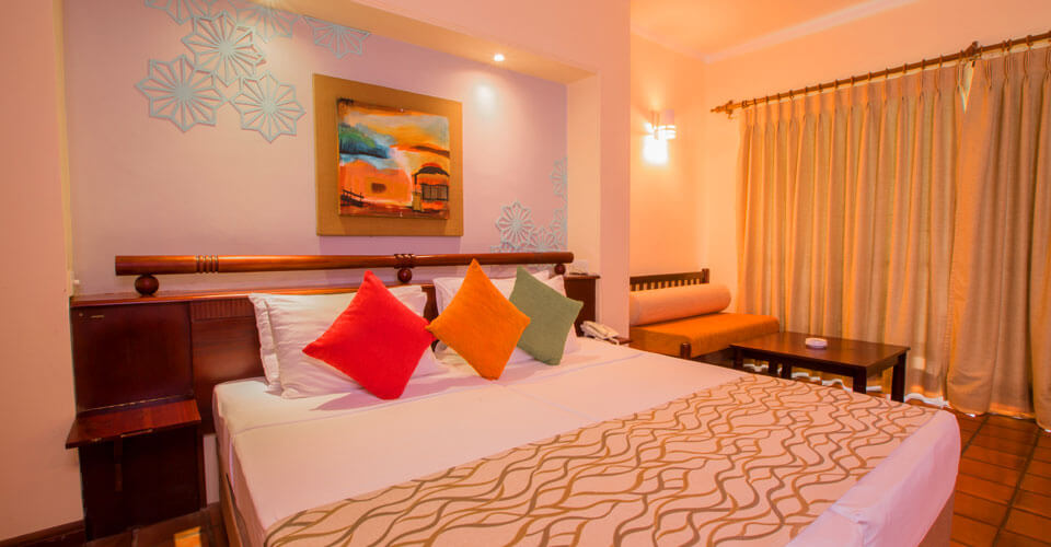 Discover comfort and space at the Deluxe Rooms at The Palms Hotel, Sri Lanka