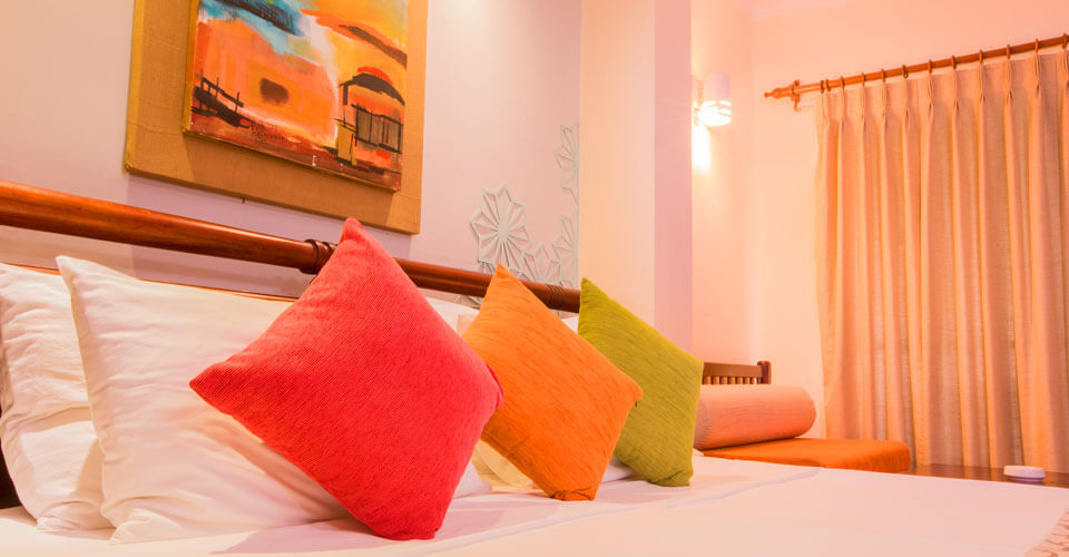 Deluxe Room at The Palms Hotel, Sri Lanka offers extra space and comfortable furnishing