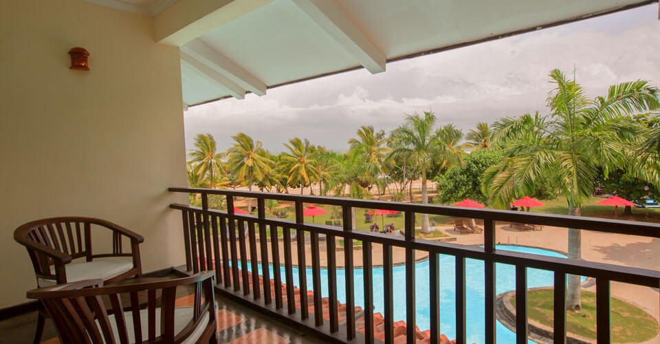 A balcony that overlooks the palm garden at The Palms Hotel, Beruwala