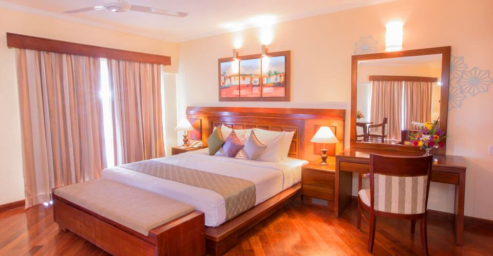 Classical earthly décor of the Sea View Suite Room at The Palms Hotel, Beruwala