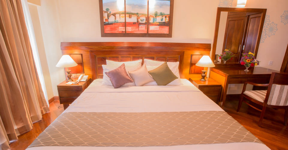King size beds and comfortable bedding at the Sea View Suite Rooms